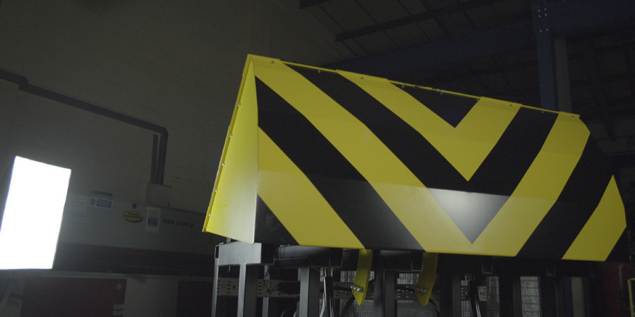 Model of crash tested road blocker that has been tested in anger